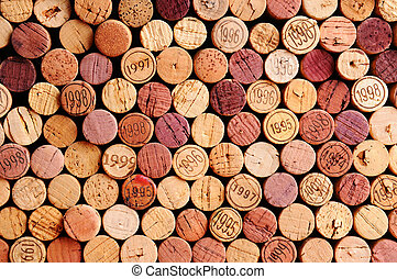 Wall of Wine Corks - Closeup of a wall of used wine corks. A...
