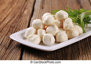 Mozzarella cheese - Fresh mozzarella cheese balls on a...