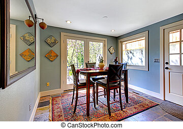 Blue dining room with red rug and high table - Blue bright...