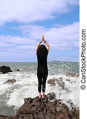 at one with nature 5 - a beautiful woman doing yoga on the...