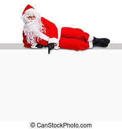 Santa lying on a blank billboard sign - Santa Claus lying on...