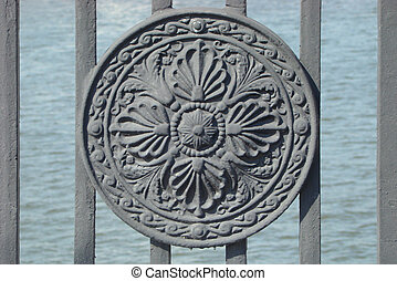 cast, pig-iron medallion decorating a handrail