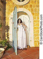 Warm sunny day - The beautiful bride in a white dress on a...