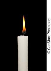 Burning candle - Burning white candle isolated against black