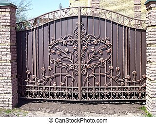 Metal iron gates of bronze color - Beautiful bronze-colored...