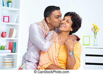 Indian male kissing his mother, living lifestyle at home