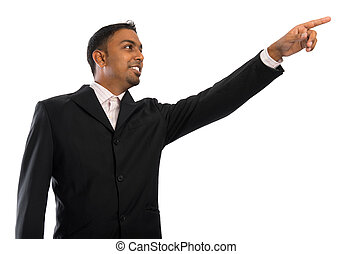Indian businessman pointing to blank space
