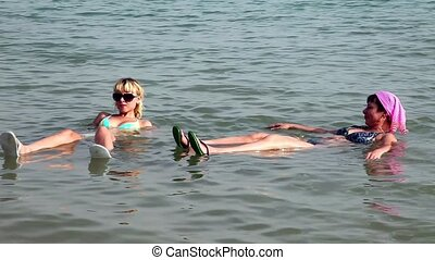 Woman and girl on the Dead Sea