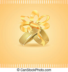 Two golden wedding rings tied up with ribbon