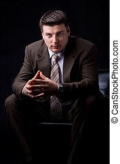 Confident rich businessman