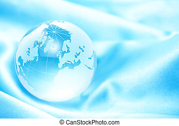 globe on light blue - Clear glass globe on light blue fabric