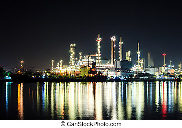 Oil refinery at twilight Chao praya river Bangkok Thailand
