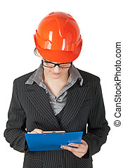 female superintendent in the construction helmet records the...