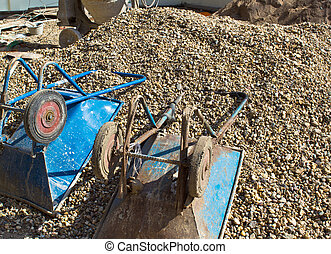 wheelbarrow, on the mound in construction site