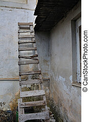 wooden broken ladder - Wooden broken ladder leaned against...