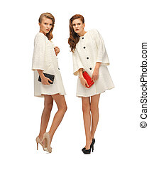 two teenage girls in white coats with clutches - picture of...
