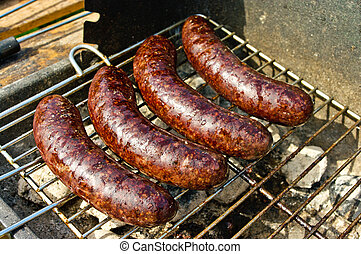 Black pudding during the preparation on the grill