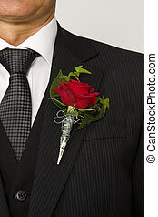 lapel flower - red rose on suit jacket of groom