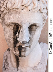 old deteriorating statue - An old, deteriorating statue in a...