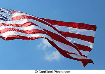 American flag waving in wind - The red white and blue of our...