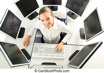 Job - View from above of businesswoman sitting at desk with...