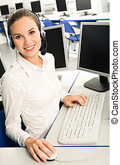 Consultant - Portrait of attractive consultant with headset...