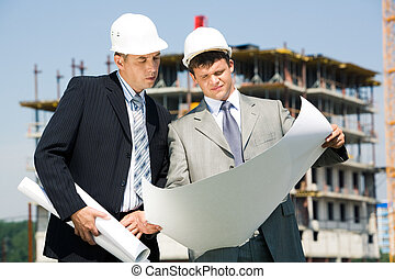 Architect and worker - Image of architect and worker looking...