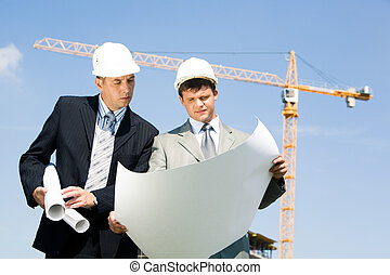 Meeting - Portrait of two confident foreman looking at...