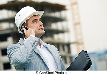 Engineer - Image of serious engineer calling on his mobile...
