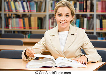 Diligent student - Portrait of happy student sitting in...