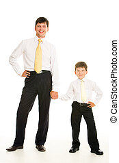 Father and son - Portrait of smiling man and his son holding...