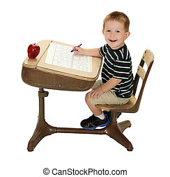 Grade School Student at his Desk - A school student is happy...