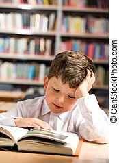 Interesting book - Vertical image of interested schoolkid...