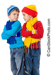 Two quarreling kids in winter clothes