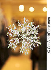 Christmas snowflake in holiday window xmas background