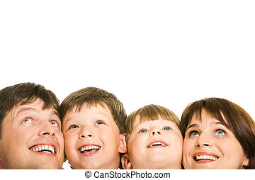 Joy - Photo of happy family looking upwards on white...