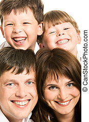 Family - Photo of smiling father, mother and two siblings...