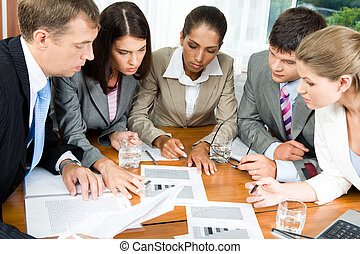 Brainstorming - Image of five people looking at...