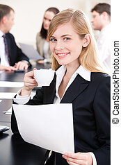 During break - Portrait of pretty businesswoman with cup of...