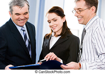 Business group of three people discussing plan at meeting