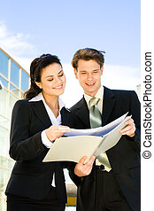 Teamwork - Image of happy businessman and businesswoman...