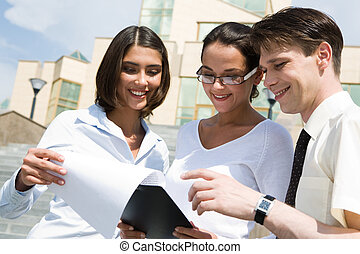 Paperwork - Portrait of friendly people discussing new...