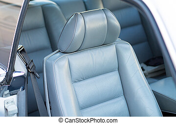 leather seat in car - grey leather seat in a luxury car