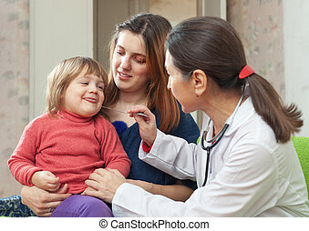 mature pediatrician examining 2 years child - mature...
