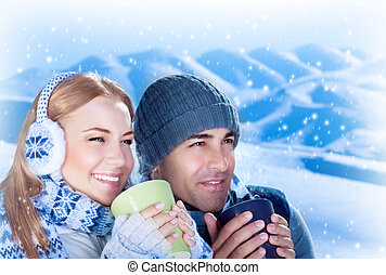 Happy couple - Picture of happy couple drink hot chokolate...