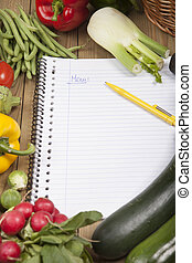 Book surrounded with variety of vegetables