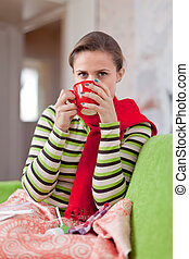 illness woman with hot cup - illness woman in warm scarf...