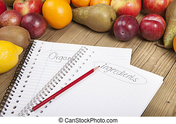 Pencil and books with fruits