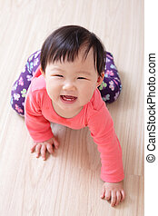 crawling baby girl smile - crawling baby girl on living room...