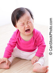 portrait of crying baby girl on living room at home, asian...